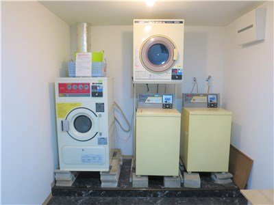 There are  equipped washing machine & drier